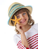 Happy little girl holding a starfish Royalty Free Stock Photos