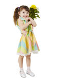 Happy little girl holds bouquet of flowers Stock Photo