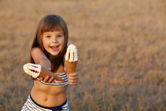 Girl holding ice cream Royalty Free Stock Photo