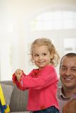Happy little girl at home Stock Image