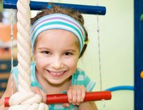 Happy little girl at home Royalty Free Stock Image