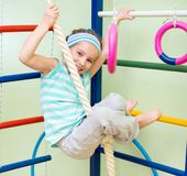 Happy little girl at home gym Royalty Free Stock Photography