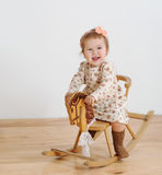 Happy little girl and horse - rocking chair Royalty Free Stock Images