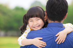 Happy little girl hugging embracing her father Royalty Free Stock Photos