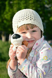 Happy little girl hugging her favorite toy. Stock Photos