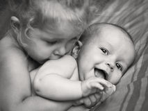 Happy little girl hugging kissing brother Royalty Free Stock Photo