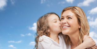 Happy little girl hugging and kissing her mother Stock Image