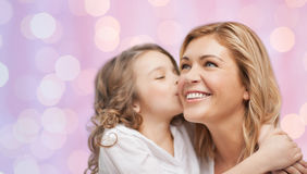 Happy little girl hugging and kissing her mother Royalty Free Stock Images