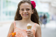 Happy little girl with ice cream in hand Stock Image