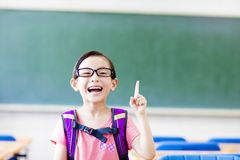 Happy little girl with idea gesture in the classroom Stock Photos