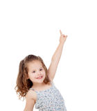 Happy little girl indicating something with the finger Stock Image