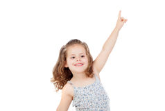 Happy little girl indicating something with the finger Stock Images