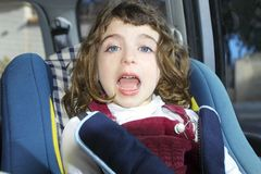 Happy little girl inside car security Royalty Free Stock Photos