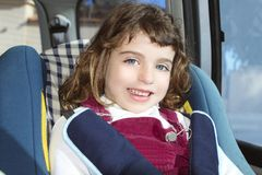 Happy little girl inside car security chair Royalty Free Stock Image