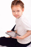 Happy little girl with ipad Stock Photo