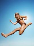 Happy little girl jumping Stock Photo