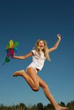 Happy little girl jumping Stock Photos