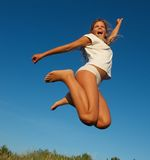 Happy little girl jumping Royalty Free Stock Photo