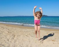 Happy little girl jumping Stock Photo