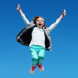Happy little girl jumping against clear sky Royalty Free Stock Images