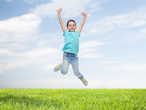 Happy little girl jumping in air Stock Photography