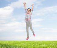Happy little girl jumping in air Royalty Free Stock Images