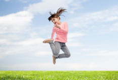 Happy little girl jumping in air Stock Image