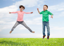 Happy little girl jumping in air Royalty Free Stock Photo