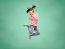 Happy little girl jumping in air over school board Royalty Free Stock Photography