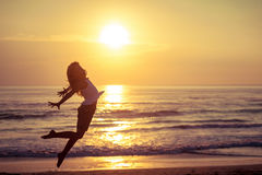 Happy little girl jumping on the beach Royalty Free Stock Photo