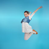 Happy little girl jumping Stock Photos