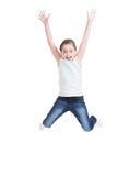 Happy little girl jumping. stock photos