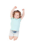 Happy little girl jumping Stock Images