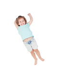 Happy little girl jumping Royalty Free Stock Images