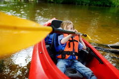 Happy little girl on a kayak on a river Royalty Free Stock Image