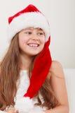 Happy little girl kid in santa hat. Christmas. Stock Image