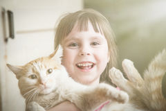 Happy little girl with kitten.. Happy little girl with kitten at home Stock Images