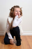 Happy little girl kneeling Stock Photo