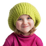 Happy little girl in a knit cap Stock Photos