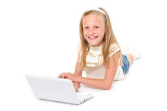 Happy little girl with laptop Royalty Free Stock Image
