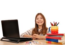Little girl with laptop at home Royalty Free Stock Photos