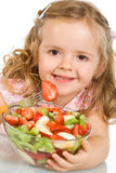 Happy little girl with a large bowl of fruit salad Stock Photography