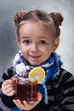 Little girl with large cup of tea Stock Photo