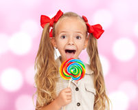 Happy little girl with large lollipop Royalty Free Stock Photography