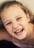 Happy little girl is laughing Stock Image