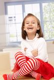 Happy little girl laughing in tailor seat Royalty Free Stock Images