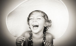 Happy little girl laughing Stock Photography