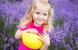 Happy little girl is in a lavender field Royalty Free Stock Image