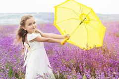 Happy little girl in lavender field with yellow royalty free stock photos