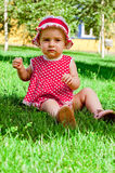 Happy little girl on a lawn Royalty Free Stock Photography